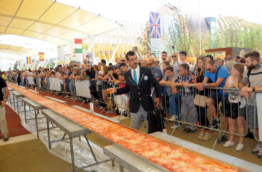 What's the world's record-setting pizza? Sixty pizza makers last month worked on this almost milelong pizza for Expo 2015 near Milan, Italy. Their work paid off: Guinness World Records confirmed it was the world's longest pizza (specifically 1.59545 kilometers).