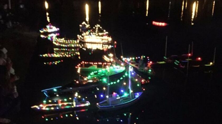 Parade of Lights? Yes, but on a miniature scale. The San Diego Argonauts model boat club members staged their parade on the model boat pond on Vacation Isle last December.