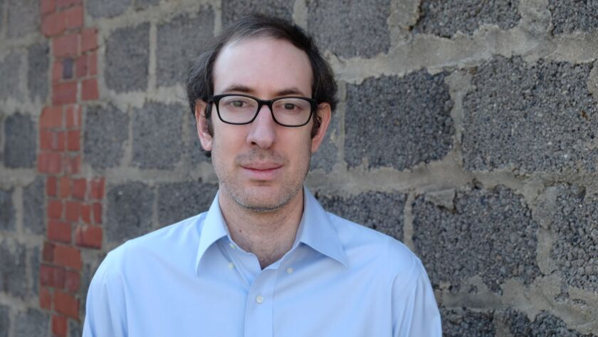 """An author photo for Josh Levin for his new book """"The Queen: The Forgotten Life Behind and American M"""