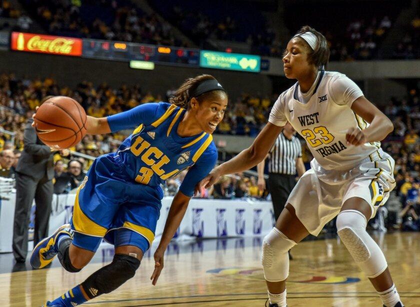 UCLA's Jordin Canada (3) drive to the basket in the final seconds of the WNIT championship college basketball against West Virginia's Bria Holmes, Saturday, April. 4, 2015, in Charleston, W.Va. UCLA won 62-60 (AP Photo/Tyler Evert)