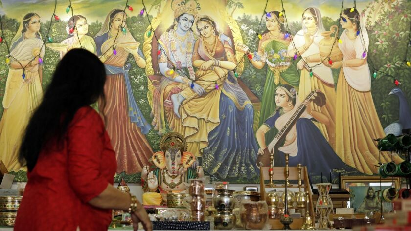 A painting of Krishna decorates a wall at Samosa House in Los Angeles. The market and restaurant on Washington Boulevard is one of the oldest South Asian businesses in the Palms and Culver City area, opening as Bharat Bazaar in 1979.