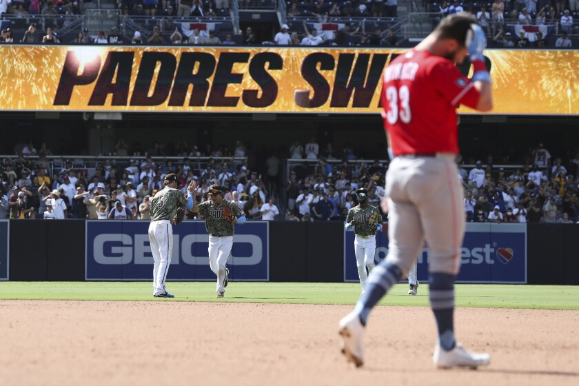 San Diego Padres right fielder Wil Myers, left, and shortstop Ha-seong Kim celebrate