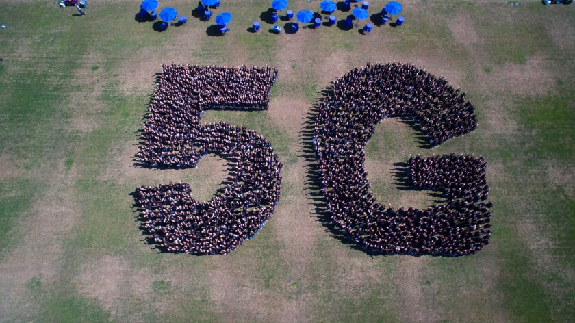 Qualcomm employees gathered last year to spell out 5G.