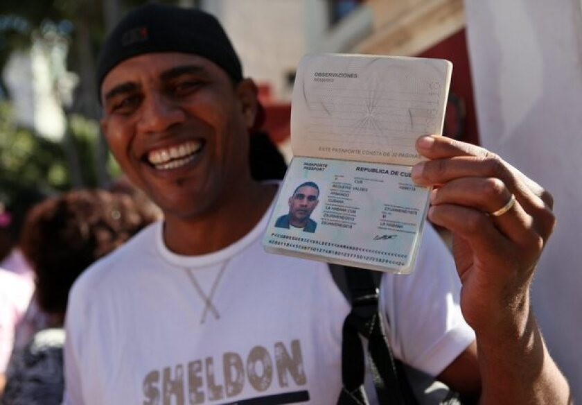 A man shows his passport in Havana.