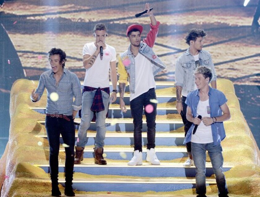 """British boy band One Direction, shown during the Teen Choice Awards recently in Los Angeles, has been supported by the Who's Pete Townshend in a debate over similarities between its hit """"Best Song Ever"""" and the Who's """"Baba O'Riley."""""""