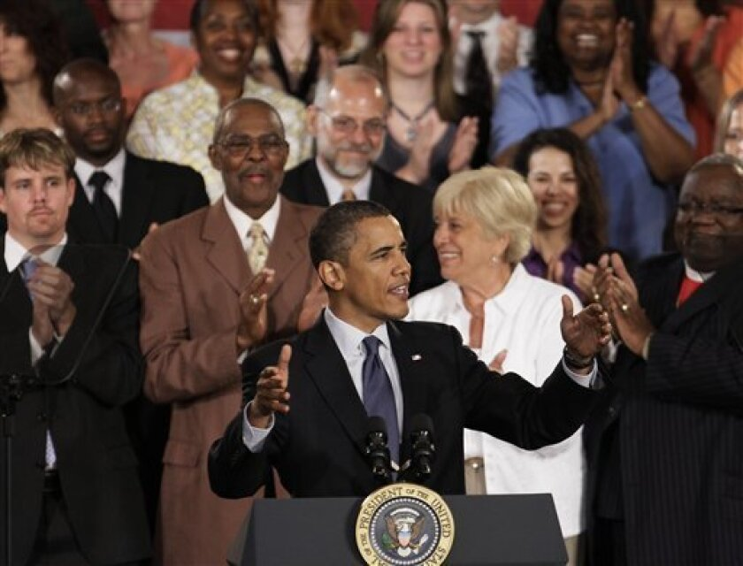 President Barack Obama acknowledges the crowd during a town hall meeting, Wednesday, June 30, 2010, in Racine, Wis. (AP Photo/M. Spencer Green)