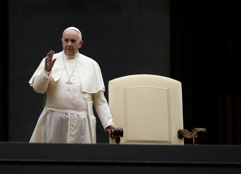 Pope Francis arrives for a vigil in St. Peter's Square at the Vatican, Saturday, Oct. 4, 2014. Pope Francis on Sunday opens a two-week meeting of bishops and cardinals from around the world aimed at making the church's teaching on family life, marriage, sex, contraception, divorce and homosexuality, relevant to today's Catholic families. The pre-synod debate has been dominated by mudslinging between liberals and conservatives over divorce and remarriage, but there are many more issues up for discussion. (AP Photo/Alessandra Tarantino)