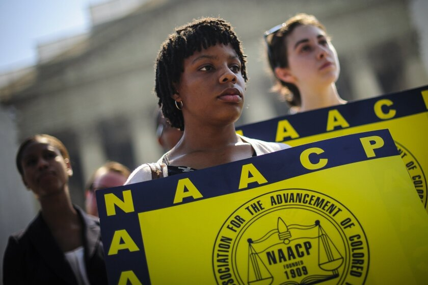 Jessica Pickens, 19, of Chicago, Ill., stands with fellow voting rights activists outside the Supreme Court in Washington, D.C., the day the court ruled on the Voting Rights Act, striking down portions of the law.