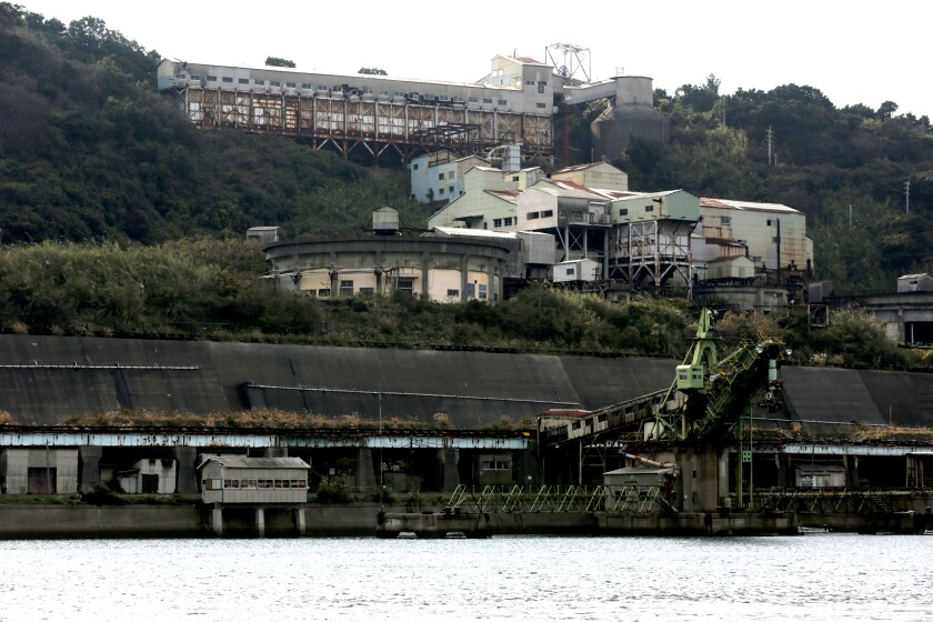 Heavy industrial buildings along the waterfront