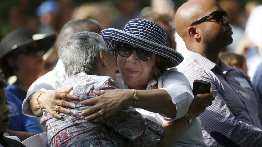 Gold Star family members Irene Ramirez of Pasadena, left, and Deborah Whitley of Altadena hug during