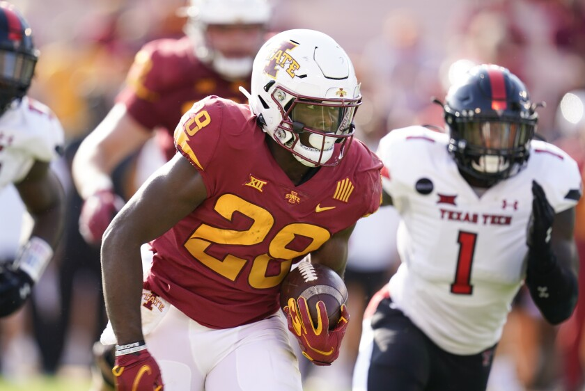FILE - In this Saturday, Oct. 10, 2020 file photo, Iowa State running back Breece Hall (28) runs from Texas Tech linebacker Krishon Merriweather (1) during the first half of an NCAA college football game in Ames, Iowa. Some things to watch in the Big 12 on Saturday, Oct 24, 2020.the first time in three weeks with a full slate of conference games: No. 17 Iowa State at No. 6 Oklahoma State.(AP Photo/Charlie Neibergall, File)
