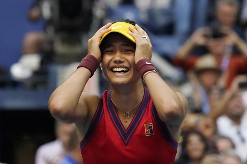 Emma Raducanu, of Britain, reacts after defeating Leylah Fernandez, of Canada.