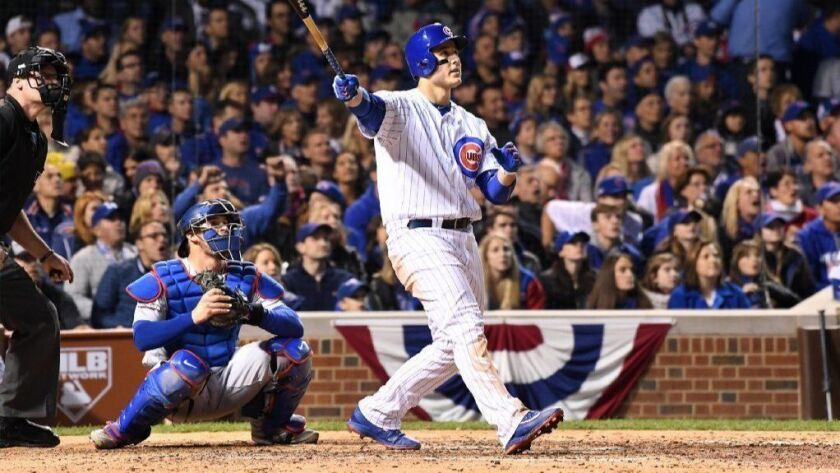 sports shoes 2d989 fd068 Cubs slugger Anthony Rizzo circles the bases on a home sale ...