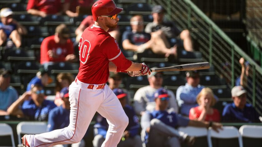 The Angels' Jonathan Lucroy singles against the Texas Rangers during a spring training game at Tempe (Ariz.) Diablo Stadium on Thursday.