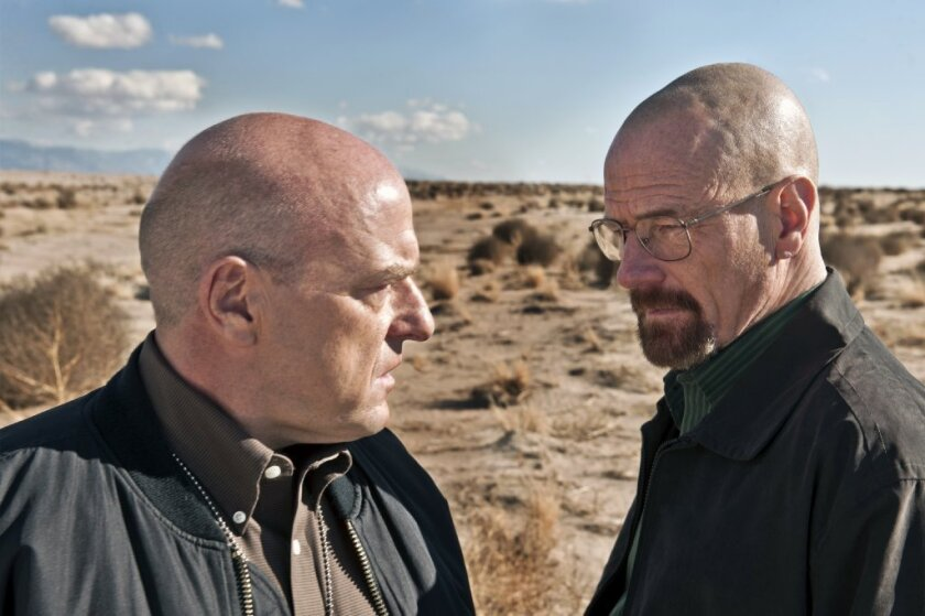 """Bryan Cranston, right, and Dean Norris costar in """"Breaking Bad,"""" which hit an all-time ratings record on Sunday."""