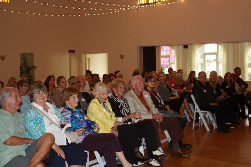 Approximately 75 people — men and women — fill the Woman's Club June 3 to hear Bonnie Dumanis.