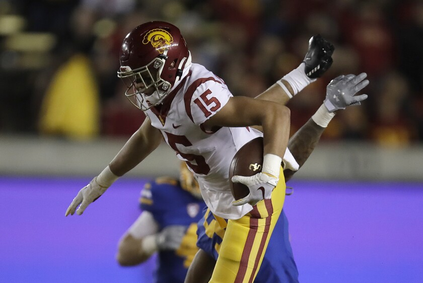 USC wide receiver Drake London leaps over California safety Trey Turner III.