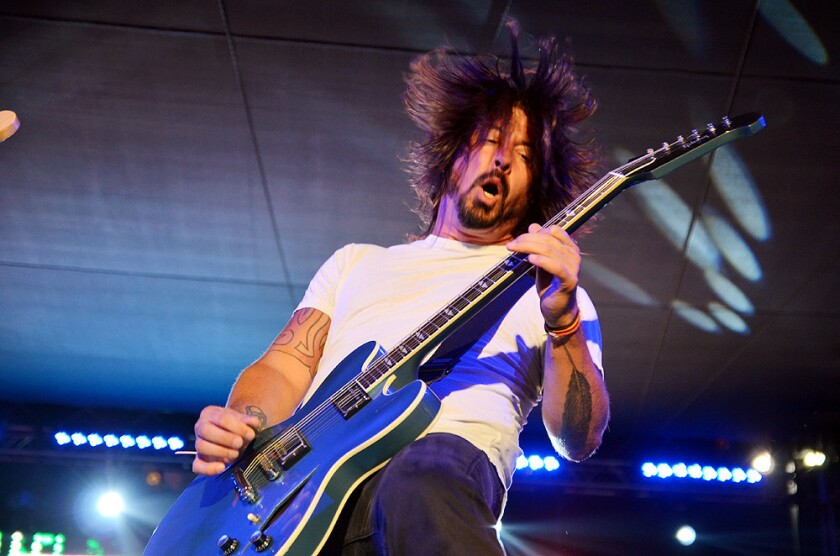 Dave Grohl performs with Chevy Metal at Costa Mesa's 60th anniversary celebration on Saturday.