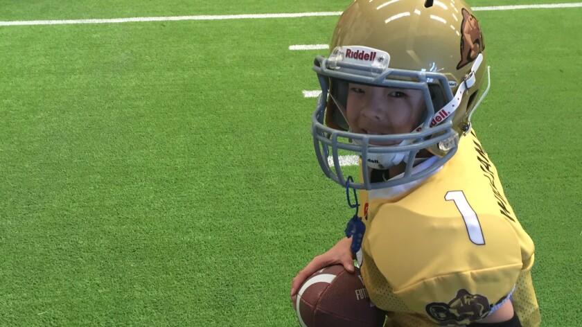 Liu Sicheng, 10, participates in a football clinic in China.