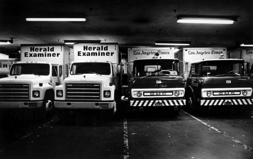 Oct. 11, 1983: Los Angeles Herald Examiner and Los Angeles Times delivery trucks share the Times Mirror Square concourse after a power outage shuts down the Herald Examiner presses.
