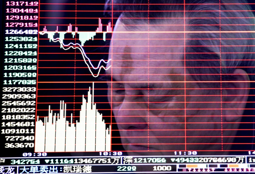 A man is reflected on a monitor screen displaying stock index at a brokerage house in Handan in north China's Hebei province, Monday, Jan. 4, 2016. Shanghai's stock index plunged nearly 7 percent on Monday, sparking a halt in trading of Chinese shares, after weak manufacturing data and Middle East tensions weighed on Asian markets.