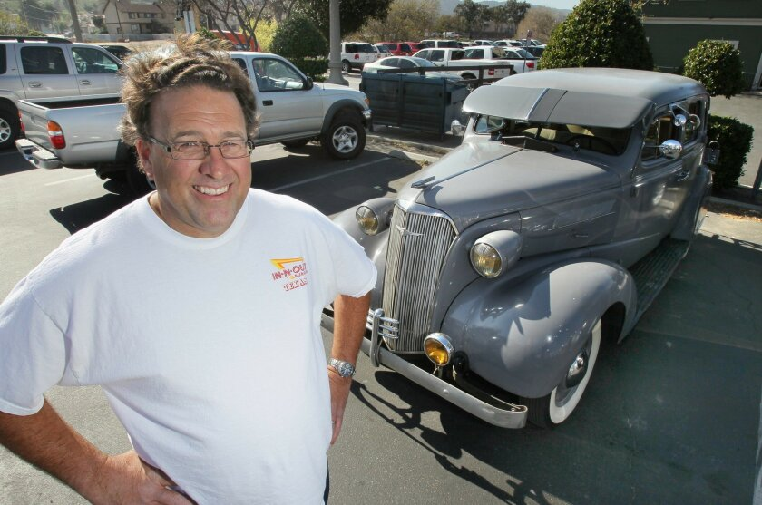 Temecula resident Rusty Ellis with his 1937 Chevy Master in the parking lot of Mad Madelines Grill on Front Street.