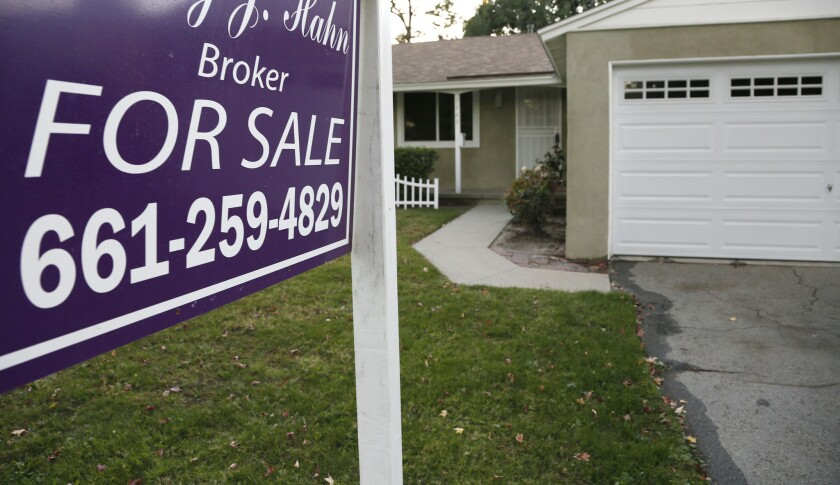 After years of boom and bust, home prices and sales in Southern California are now responding to the very thing they should: job and income growth, not loose lending standards or investors, economists and real estate analysts say. Above, a home for sale in L.A. this month.