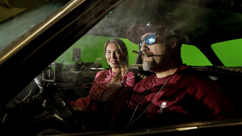 Stephanie Smith, left, specializes in renting out cannabis-grow facilities throughout Los Angeles. One of her most prominent tenants is Cypress Hill frontman B-Real, right, on the set of his pot-centric YouTube series.