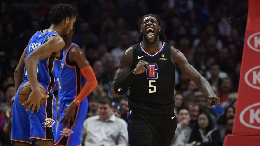 Clippers forward Montrezl Harrell, right, celebrates after scoring and drawing a foul as Oklahoma City Thunder guard Terrance Ferguson, left, stands by during the second half.
