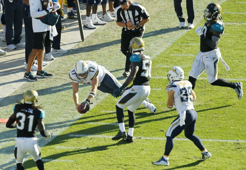 Philip Rivers dives at the end of an eight-yard run for a first down in the fourth quarter.