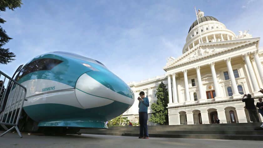 A full-scale mock-up of a high-speed train is displayed at the state Capitol in Sacramento.