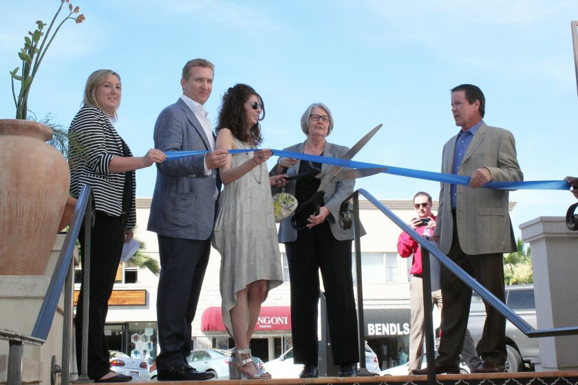 Sydney Davison of Bay Bird public relations, Davlyn Investments CEO Jon Williams and wife, Tammy Williams; San Diego City Council President Sherri Lightner and Davlyn Investments President Paul Kerr cut the ribbon marking La Plaza La Jolla's opening.