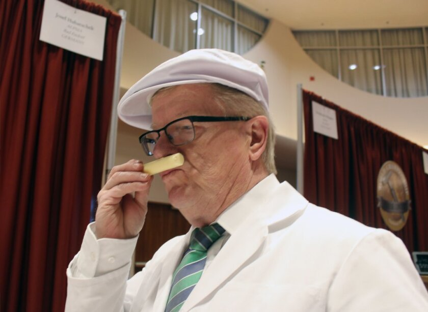 Josef Hubatschek of Germany smells a sample from the 2014 World Championship Cheese Contest. A new study concludes that humans can detect 1 trillion different smells.