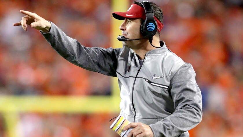 Steve Sarkisian communicates with Alabama players during the College Football Playoff title game on Jan. 9.