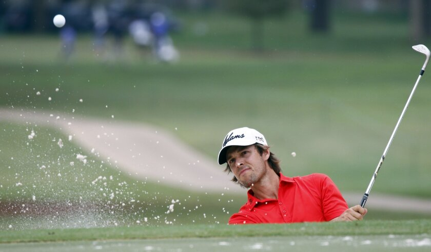 Aaron Baddeley of Australia hits out of a sand trap on the No. 5 fairway during the first round of the Sanderson Farms Classic golf tournament at the Country Club of Jackson, Thursday, Nov 5, 2015, in Jackson, Miss. (AP Photo/Rogelio V. Solis)