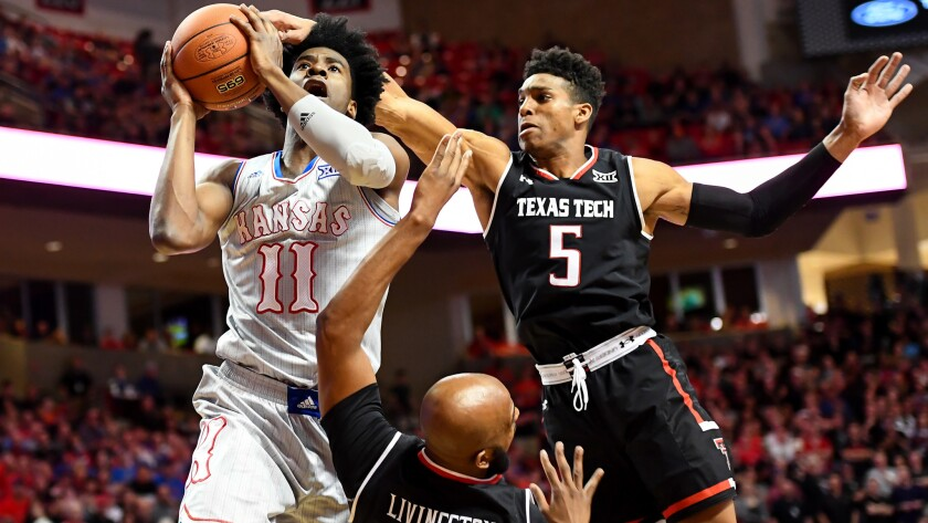 Kansas guard Josh Jackson tries to score against Texas Tech's Justin Gray (5) and Anthony Livingston during the first half Saturday.