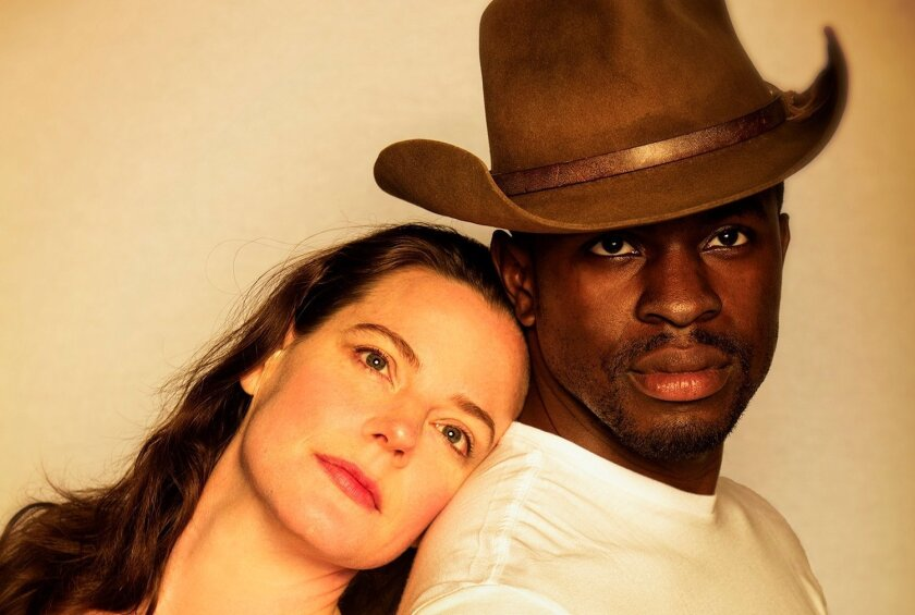 "Danielle Skraastad (left) is Lizzie Curry and Gbenga Akinnagbe is Bill Starbuck in the Old Globe Theatre production of N. Richard Nash's ""The Rainmaker."""
