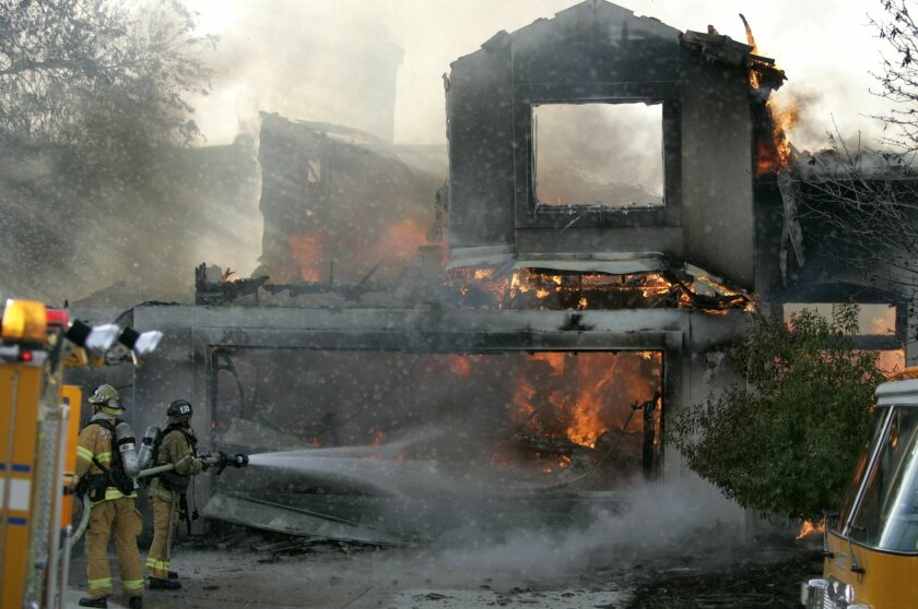 The two-story house on Clifford Heights Road was reduced to charred, unstable walls as a result of Saturday's fire.