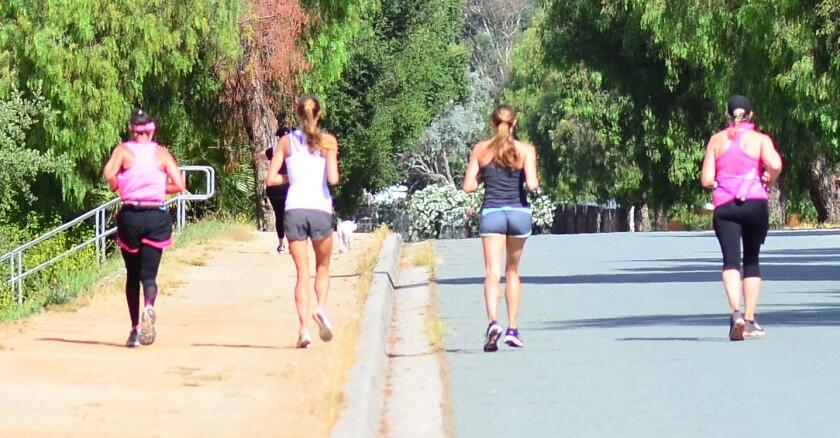 Marathoner Kelly Van Zant Maine, supported by Meriah Earle, Marissa Earle and Kathy Pierce Linenberger.