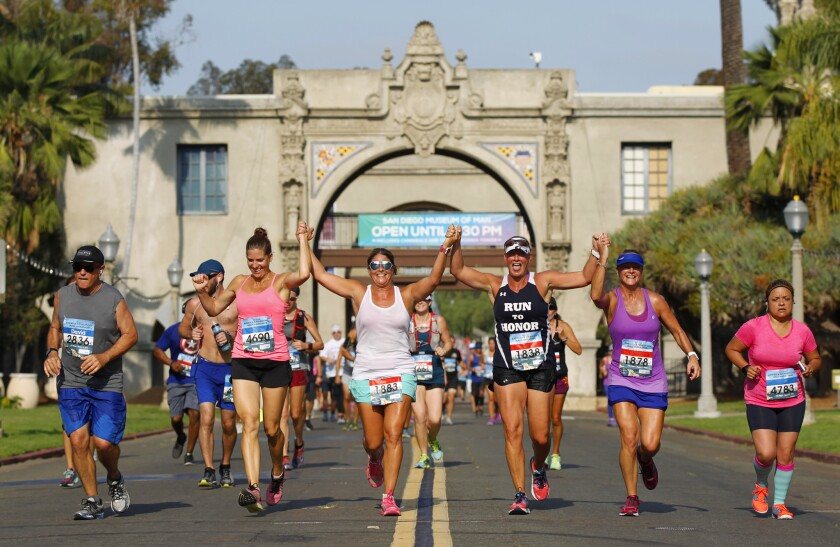 Runners in the America's Finest City Half Marathon make their way through Balboa Park.(Photo by K.C. Alfred/The San Diego Union-Tribune)