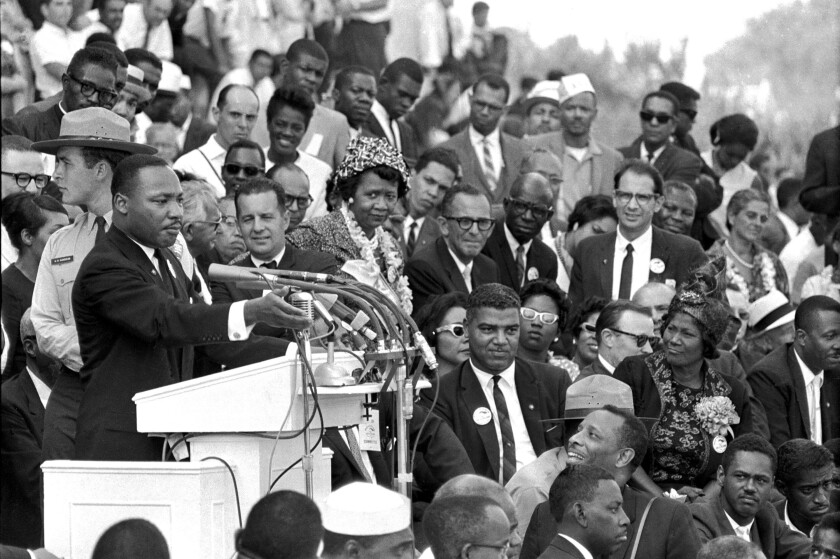 """FILE - In this Aug. 28, 1963 file photo, the Rev. Dr. Martin Luther King Jr., head of the Southern Christian Leadership Conference, speaks to thousands during his """"I Have a Dream"""" speech in front of the Lincoln Memorial for the March on Washington for Jobs and Freedom, in Washington. A new documentary """"MLK/FBI,"""" shows how FBI director J. Edgar Hoover used the full force of his federal law enforcement agency to attack King and his progressive, nonviolent cause. That included wiretaps, blackmail and informers, trying to find dirt on King. (AP Photo/File)"""