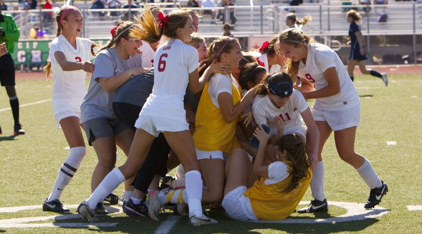 Cathedral Catholic High School celebrates after defeating Del Norte High School for the CIF Division III Girls Soccer Championships.