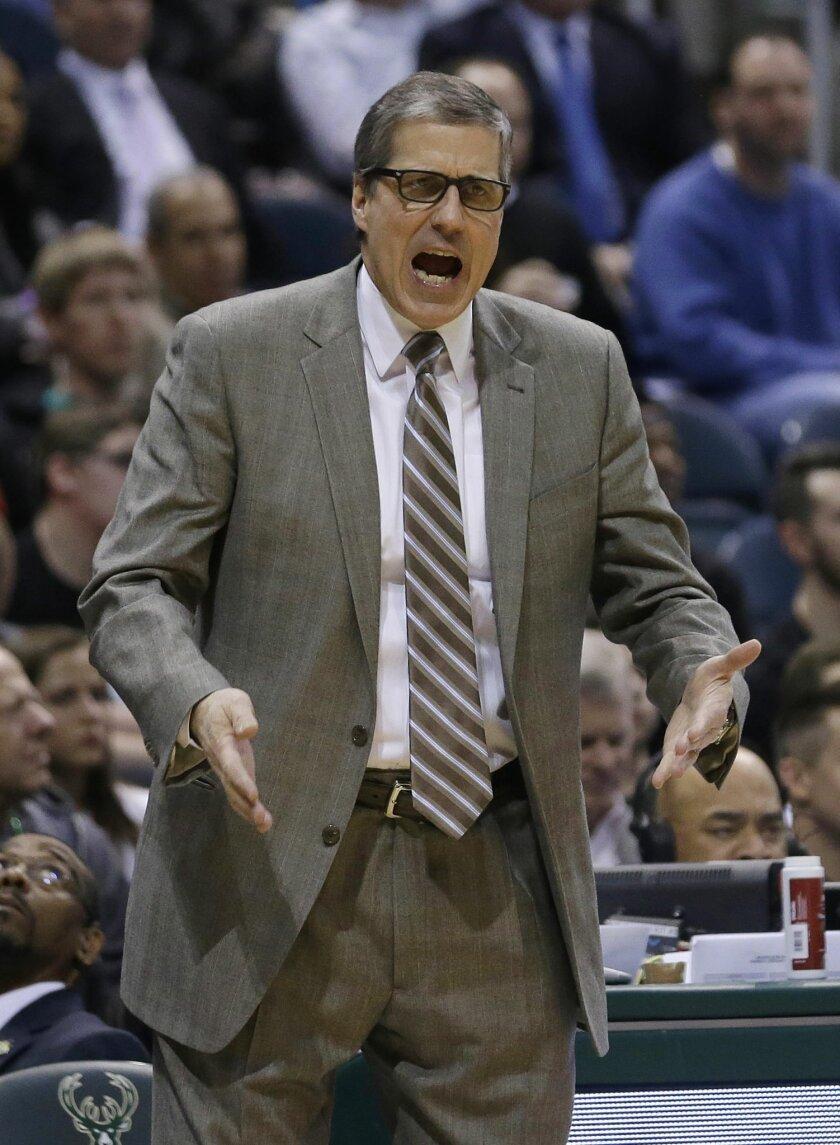 Washington Wizards head coach Randy Wittman yells to his team during an NBA basketball game against the Milwaukee Bucks Thursday, Feb. 11, 2016, in Milwaukee. (AP Photo/Aaron Gash)