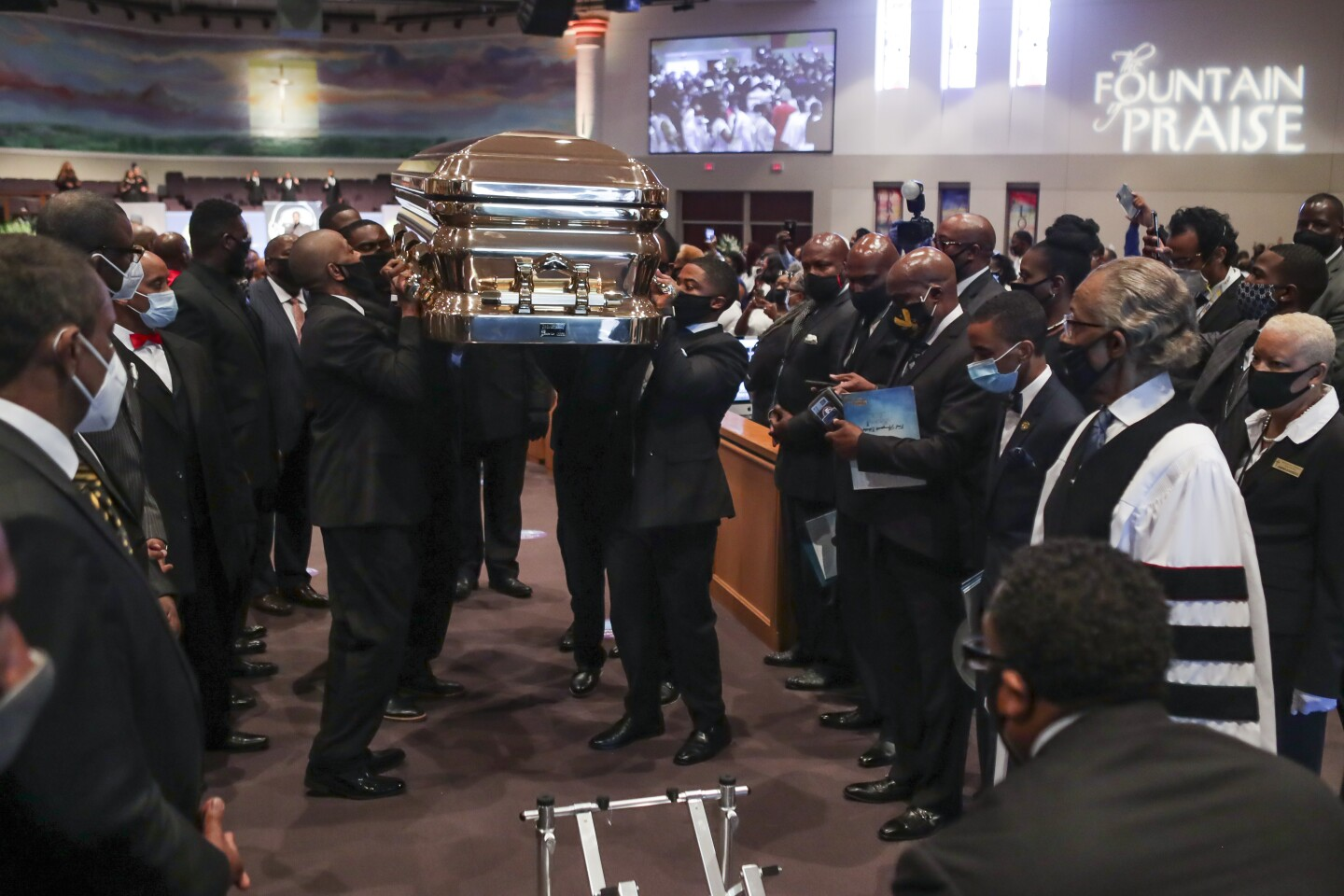 Pallbearers carry the casket following the funeral of George Floyd June 9, 2020, at The Fountain of Praise church in Houston. - George Floyd will be laid to rest Tuesday in his Houston hometown, the culmination of a long farewell to the 46-year-old African American whose death in custody ignited global protests against police brutality and racism. Thousands of well-wishers filed past Floyd's coffin in a public viewing a day earlier, as a court set bail at $1 million for the white officer charged with his murder last month in Minneapolis. (Photo by Godofredo A. VASQUEZ / POOL / AFP) (Photo by GODOFREDO A. VASQUEZ/POOL/AFP via Getty Images)