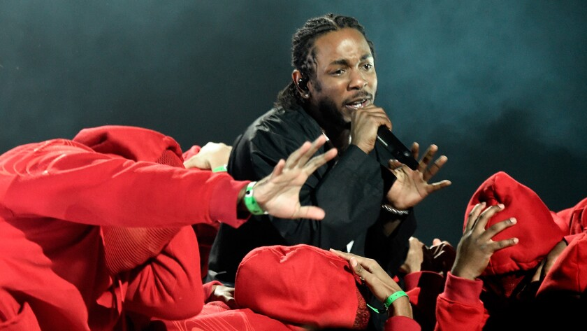 Hip-hop star Kendrick Lamar won five Grammy Awards and performed during the awards show.