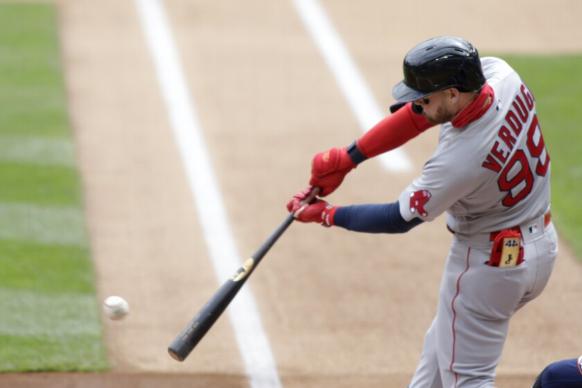 Boston Red Sox center fielder Alex Verdugo hits a single against the Minnesota Twins in the first inning during a baseball game, Wednesday, April 14, 2021, in Minneapolis. (AP Photo/Andy Clayton-King)
