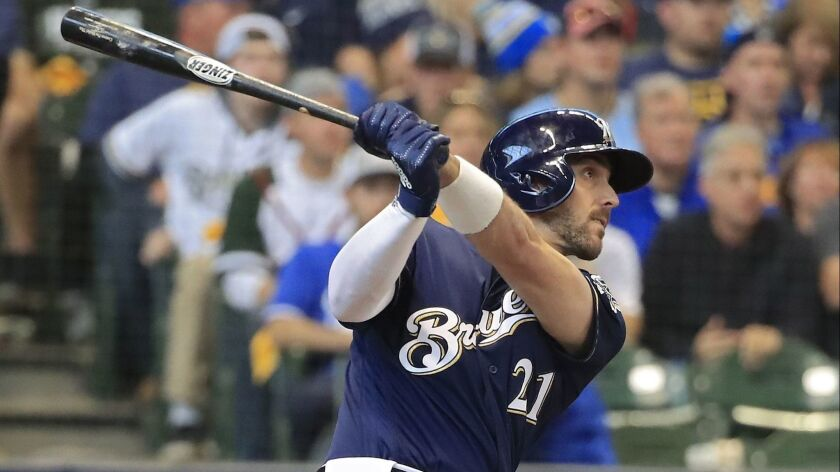 Milwaukee Brewers' Travis Shaw with a solo home run in the sixth inning against the Dodgers in Game 2 of the National League Championship Series at Miller Park in Milwaukee on Saturday.
