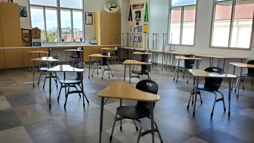Student desks and chairs are spaced several feet apart in a classroom at newly rebuilt Hoover High School in San Diego.