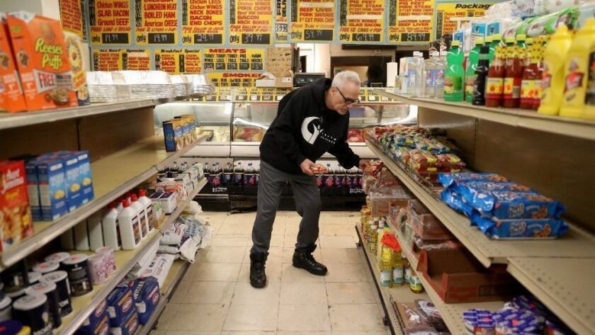 Michael Montagano picks out noodles to pay for using his LINK card at SZ Food Mart in Chicago's Englewood neighborhood, on Jan. 11, 2019.