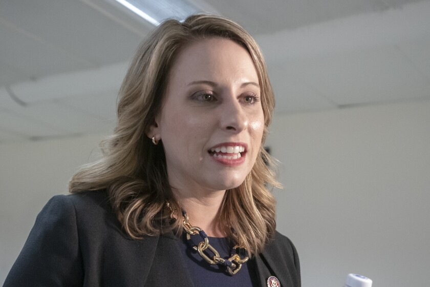 """FILE - In this April 3, 2019, file photo, Rep. Katie Hill, D-Calif., talks on Capitol Hill in Washington. The former US House Twitter account of ex-Rep. Hill was hacked Wednesday, Oct. 7, 2020, purportedly by """"former staff"""" who criticized a planned movie about her life and accused Hill of workplace abuse. (AP Photo/J. Scott Applewhite, File)"""